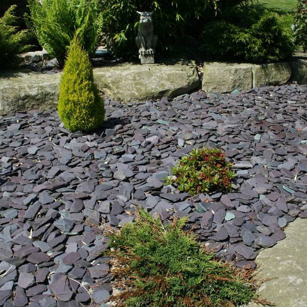 Tumbled blue paddlestones 50 100mm landscaping for Blue slate garden designs