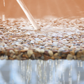Resin-bound rubber surfaces allow water to drain through